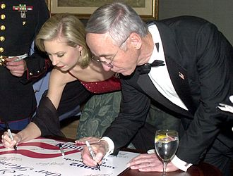 Miss Oregon - Katie Harman, Miss America 2002, signs a poster at a USO dinner.