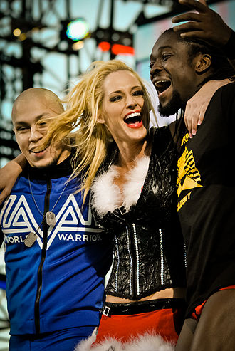 Low Ki - Kaval (left) with Michelle McCool, his NXT mentor (middle), and Kofi Kingston (right) at Tribute to the Troops in December 2010.