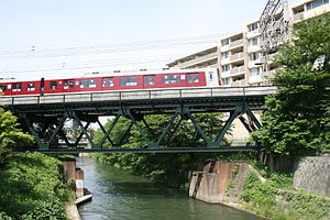 Nara Line (JR West) - Abandoned abutments of a bridge on the former route of the Nara Line are under the bridge of the Kintetsu Kyoto Line.