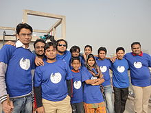 people standing in a group wearing Wikipedia shirts