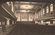 black-and-white photograph of the interior of a large empty concert hall