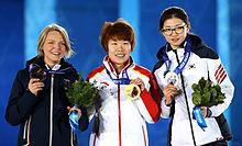Il podio olimpico dei 1500 m: Arianna (bronzo), Zhou (oro), Shim (argento)