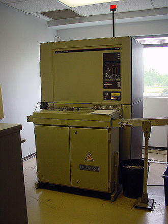 X-ray fluorescence - A Philips PW1606 X-ray fluorescence spectrometer with automated sample feed in a cement plant quality control laboratory