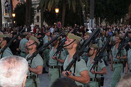 In many Christian countries, religious processions during the season of Lent are often accompanied by a military escort both for security and parade. Ceuta, Spain Legionarios en la procesion de El Encuentro (Semana Santa en Ceuta, 2012).jpg