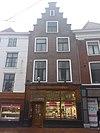 foto van Pand met trapgevel en winkelpui van smid