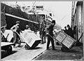 Longshoremen unloading cargo from a freighter by handtruck, 1906 (MOHAI 7221).jpg