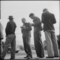 Los Angeles, California. Lockheed Employment. Holding their places in the waiting line by making out the preliminary... - NARA - 532203.tif