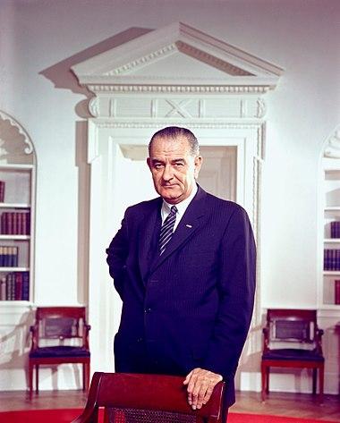 Lyndon B. Johnson, photo portrait, Smileanelse on chair, color.jpg