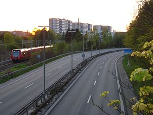 Sorgenfri - Lyngby Omfartsvej with a view towards Sorgenfri station at the exit to Sorgenfri with the S-train.