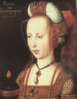 1400–1500 in European fashion - Mary of Burgundy wears a headdress comprising a truncated-cone hennin, a jewelled padded roll, and a sheer veil.
