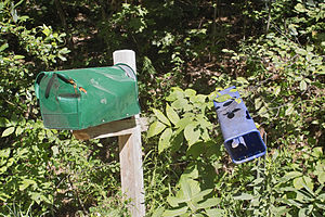 Property crime - A mailbox (left) that was damaged by a game of mailbox baseball.