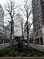 Man With Open Arms by Giles Penny, West India Avenue in March 2011 02.jpg