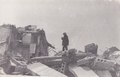 Man standing by rubble in aftermath of Spitak Earthquake.pdf