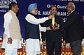 Manmohan Singh presented the National Awards to the Micro, Small & Medium Enterprises, for their outstanding entrepreneurship, at a function, in New Delhi. The Minister of State (Independent Charge) for Micro (6).jpg