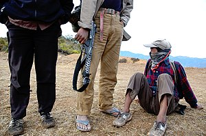 Nepalese Civil War - Three Maoist rebels wait on top of a hill for orders to relocate in the Rolpa district