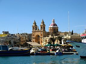 Marsaxlokk fishing village, Church from pontoon, June 2010.jpg
