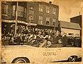 Massachusetts Senator Leverett A. Saltonstall (waving hat) riding in car with three unidentified men during parade (10290640976).jpg