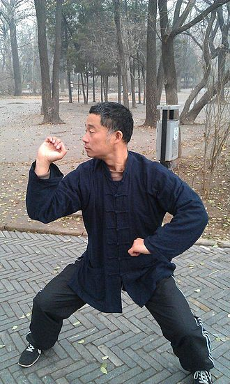 Bajiquan - Zhou Jingxuan of Tianjin, holding a typical Baji Quan posture. The sideways-protruding elbow is often used for striking in this art.