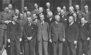 A group of men in suits pose for a picture.