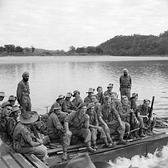 Border Regiment - Men of the 8th Battalion, Border Regiment on a ferry ready to cross the Chindwin River, between Kalewa and Shwegying, Burma, January 1945.