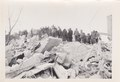 Men standing by rubble in aftermath of Spitak Earthquake.pdf