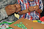 Military members, families enjoy Holiday party 161202-F-WF462-051.jpg