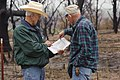 NRCS District Conservationist Tony Dean (left) discusses ranch management options with a Jack County landowner after a wildfire burned through the area three weeks earlier. (25085399076).jpg