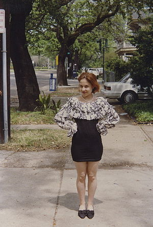 1990s in fashion - Young woman standing on sidewalk, Uptown New Orleans, 1992.
