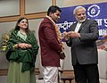 Narendra Modi conferring the National Awards for Bravery 2014 to Devesh Kumar who put his own life at risk in order to chase miscreants who were stealing from people.jpg