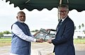 Narendra Modi presents two Indian rice varieties to IRRI gene bank at the ground breaking ceremony for resilient rice field laboratory, at the International Rice Research Institute (IRRI), in Los Banos, Philippines.jpg