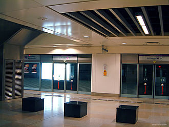 Platform screen doors - Serangoon station. The Singapore MRT was the first in the world to be fitted with glass screen doors.