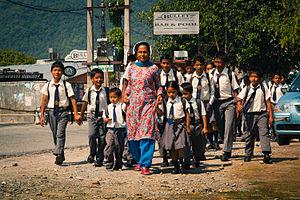 Education in Nepal - Teacher and schoolchildren in Pokhara