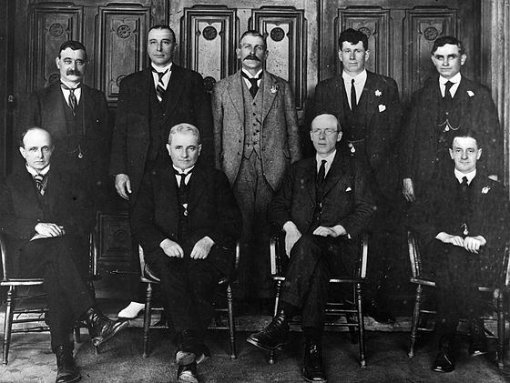 Members of the Labour parliamentary caucus, 1922. Prominent members are Harry Holland (seated, left of centre), Peter Fraser (seated, right of centre) and Michael Joseph Savage (back row, rightmost). New Zealand Parliamentary Labour Party, 1922.jpg