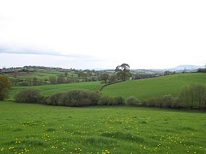 Grace Dieu Abbey, Monmouth - Valley of the River Trothy looking across the fields that once belonged to the Abbey and more recently to Parc Grace Dieu parish. Parc Grace Dieu farm, near the approximate original site of the Abbey, is at the left edge of the picture
