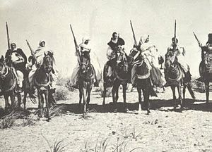 Omar Mukhtar with the Libyan Mujahideen.jpg