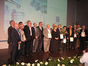 Michael Zinigrad - Professor Zinigrad (forth from right) with other recipients of the Outstanding Scientists Award 2014 and the Minister of Immigration