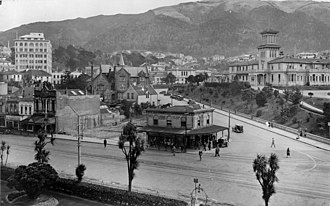Government House, Wellington - Overlooking the intersection of Lambton Quay and Bowen Street, Wellington, 1929. The former Government House (to the right, with the tower) is now the site of the Beehive.