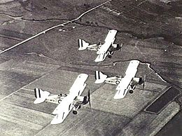 Overhead view of three single-engined biplanes in flight