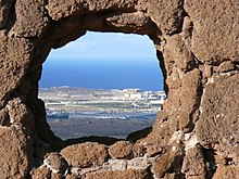 View from the Four Doors site through a hole in the rock
