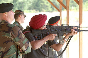 Para (Special Forces) - An Indian Para (Special Forces) officer tries a U.S. Army weapon.
