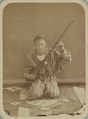 Pastimes of Central Asians. A Musician Playing a Tambur, a Long-necked Stringed Instrument WDL10828.png