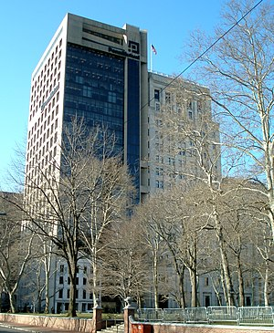 Penn Mutual - The Penn Mutual Tower (1975, left), 1931 addition (center), and 1913 headquarters building (right, hidden behind trees)