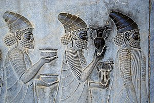 History of wine - Detail of a relief on the eastern stairs of the Apadana, Persepolis, Iran depicting ambassadors of a subject nation of the Persian Empire bringing their famous wine to the Persian king.