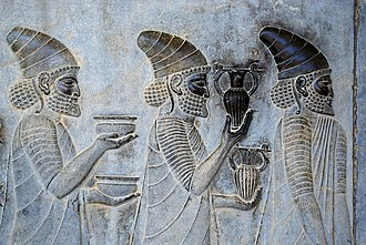 History of wine - Detail of a relief on the eastern stairs of the Apadana Palace, Persepolis, depicting Armenian ambassadors, bringing wine to the Persian Emperor.