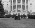Photograph of President Truman on the White House lawn receiving honorary badges from the Washington police force... - NARA - 200416.tif