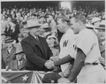 Photograph of President Truman shaking hands with Washington manager Ossie Bluege and New York Yankees manager Bucky... - NARA - 199579.tif
