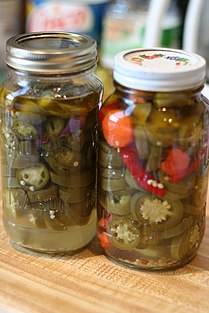 Pickled peppers with vinegar.