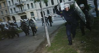 Baton charge - A baton charge during the 2001 EU summit protests in Sweden.