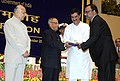 Pranab Mukherjee presenting the Hindi Award, at the Hindi Divas Function, in New Delhi. The Union Home Minister, Shri Sushil Kumar Shinde and the Minister of State for Home Affairs, Shri Jitendra Singh are also seen (2).jpg