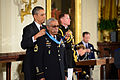 President Barack H. Obama, left, presents a Medal of Honor to former U.S. Army Sgt. 1st Class Melvin Morris in the White House in Washington, D.C., March 18, 2014 140318-A-ZI280-117.jpg